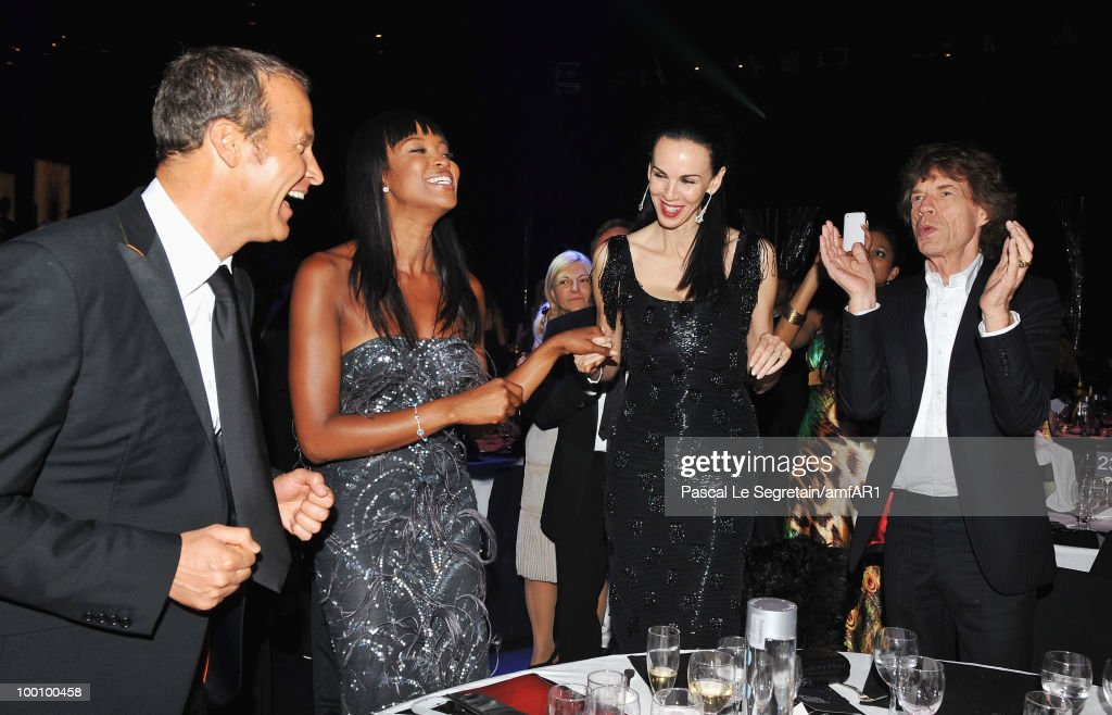 Vladislav Doronin, Naomi Campbell, L'Wren Scott and Mick Jagger attends amfAR's Cinema Against AIDS 2010 benefit gala dinner at the Hotel du Cap on May 20, 2010 in Antibes, France.