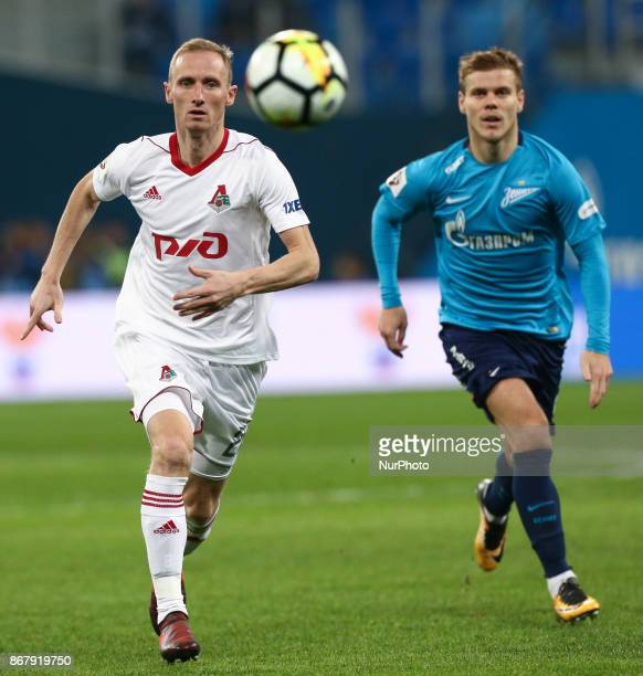 Vladislav Ignatiev of FC Lokomotiv Moskva and Aleksandr Kokorin of FC Zenit Saint Petersburg vie for the ball during the Russian Football League...