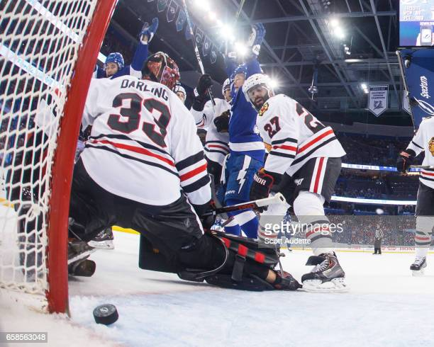 Vladislav Namestnikov and Jonathan Drouin of the Tampa Bay Lightning celebrate a goal against goalie Scott Darling and Johnny Oduya of the Chicago...