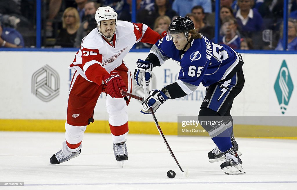 <a gi-track='captionPersonalityLinkClicked' href=/galleries/search?phrase=Vladislav+Namestnikov&family=editorial&specificpeople=7216399 ng-click='$event.stopPropagation()'>Vladislav Namestnikov</a> #65 of the Tampa Bay Lightning avoids the check of <a gi-track='captionPersonalityLinkClicked' href=/galleries/search?phrase=Jonathan+Ericsson&family=editorial&specificpeople=2538498 ng-click='$event.stopPropagation()'>Jonathan Ericsson</a> #52 of the Detroit Red Wings at the Tampa Bay Times Forum on February 8, 2014 in Tampa, Florida.