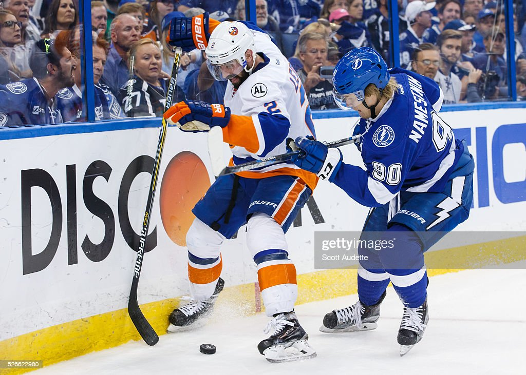 Vladislav Namestnikov #90 of the Tampa Bay Lightning battles against Nick Leddy #2 of the New York Islanders during the third period of Game Two of the Eastern Conference Second Round in the 2016 NHL Stanley Cup Playoffs at the Amalie Arena on April 30, 2016 in Tampa, Florida.