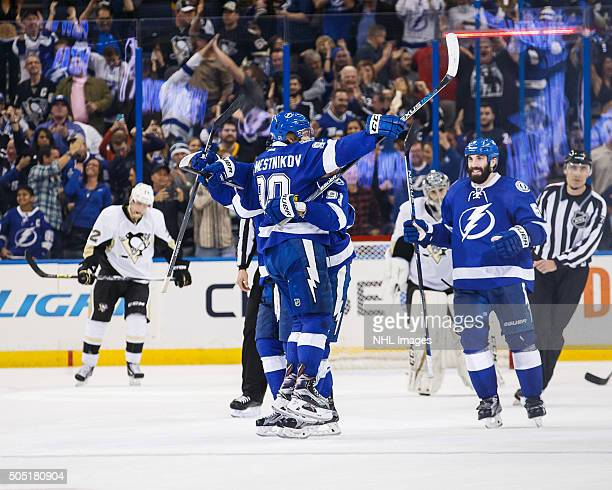Vladislav Namestnikov of the Tampa Bay Lightning celebrates his game winning goal with teammates against the Pittsburgh Penguins during the overtime...