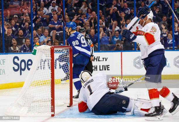 Vladislav Namestnikov of the Tampa Bay Lightning celebrates his goal against goalie Roberto Luongo and Colton Sceviour of the Florida Panthers during...