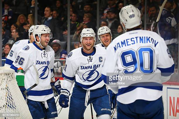 Vladislav Namestnikov of the Tampa Bay Lightning celebrates his second period goal against the New York Islanders with teammates Steven Stamkos and...