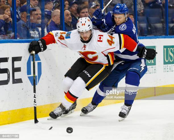 Vladislav Namestnikov of the Tampa Bay Lightning chases Matt Bartkowski of the Calgary Flames during the first period at Amalie Arena on February 23...