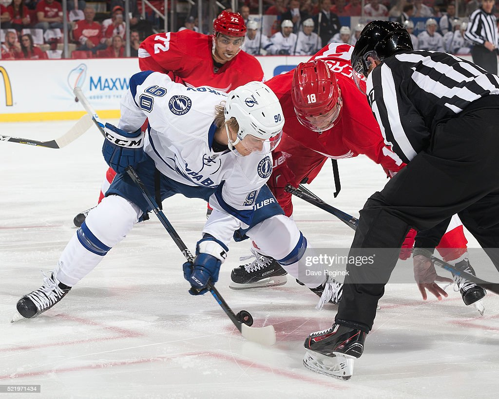 Vladislav Namestnikov of the Tampa Bay Lightning faces off against Joakim Andersson of the Detroit Red Wings during Game Three of the Eastern...