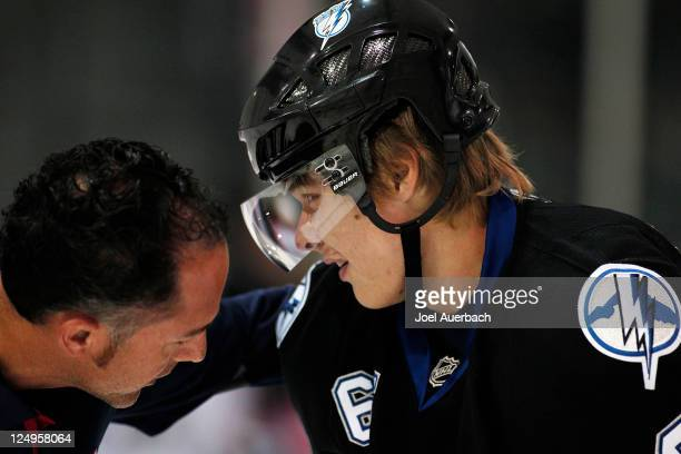 Vladislav Namestnikov of the Tampa Bay Lightning is assisted off the ice after being injured in first period action against the Florida Panthers on...