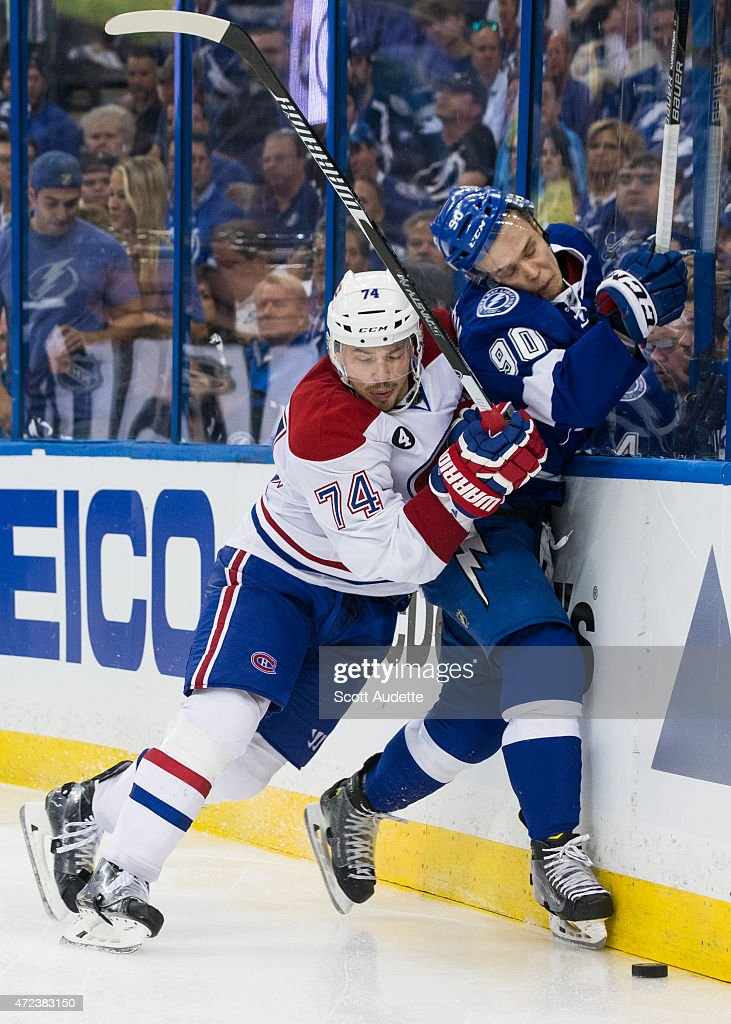 <a gi-track='captionPersonalityLinkClicked' href=/galleries/search?phrase=Vladislav+Namestnikov&family=editorial&specificpeople=7216399 ng-click='$event.stopPropagation()'>Vladislav Namestnikov</a> #90 of the Tampa Bay Lightning is checked by <a gi-track='captionPersonalityLinkClicked' href=/galleries/search?phrase=Alexei+Emelin&family=editorial&specificpeople=723573 ng-click='$event.stopPropagation()'>Alexei Emelin</a> #74 of the Montreal Canadiens during the third period in Game Three of the Eastern Conference Semifinals during the 2015 NHL Stanley Cup Playoffs at the Amalie Arena on May 6, 2015 in Tampa, Florida.