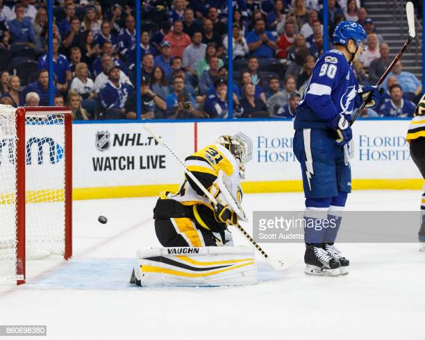 Vladislav Namestnikov of the Tampa Bay Lightning screens goalie Antti Niemi of the Pittsburgh Penguins as the puck flies into the net for a goal...