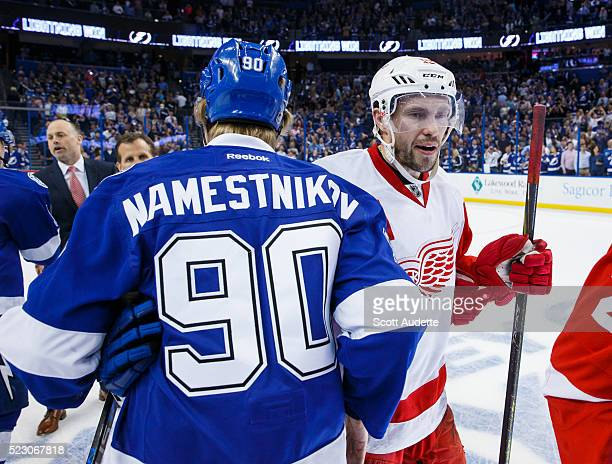 Vladislav Namestnikov of the Tampa Bay Lightning shakes the hand of Pavel Datsyuk of the Detroit Red Wings after the series win in Game Five of the...
