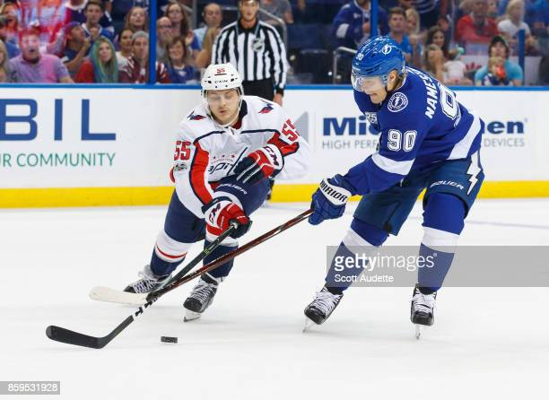 Vladislav Namestnikov of the Tampa Bay Lightning skates against Aaron Ness of the Washington Capitals during the game at Amalie Arena on October 9...