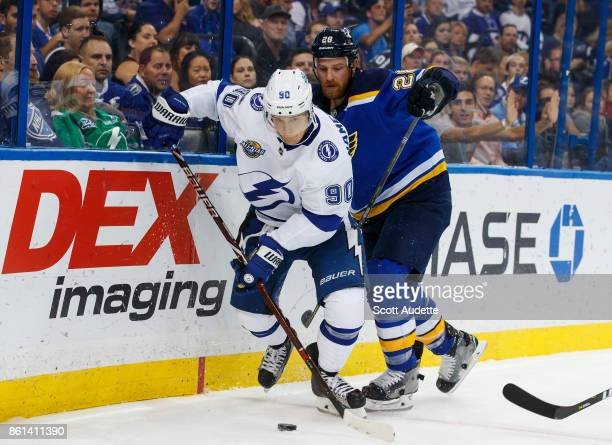 Vladislav Namestnikov of the Tampa Bay Lightning skates against Kyle Brodziak of the St Louis Blues during the third period at Amalie Arena on...