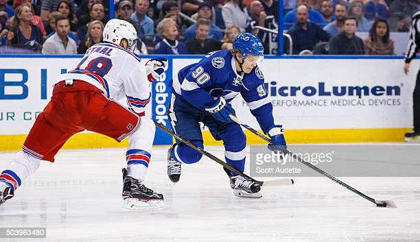 Vladislav Namestnikov of the Tampa Bay Lightning skates against Marc Staal of the New York Rangers during the third period at the Amalie Arena on...
