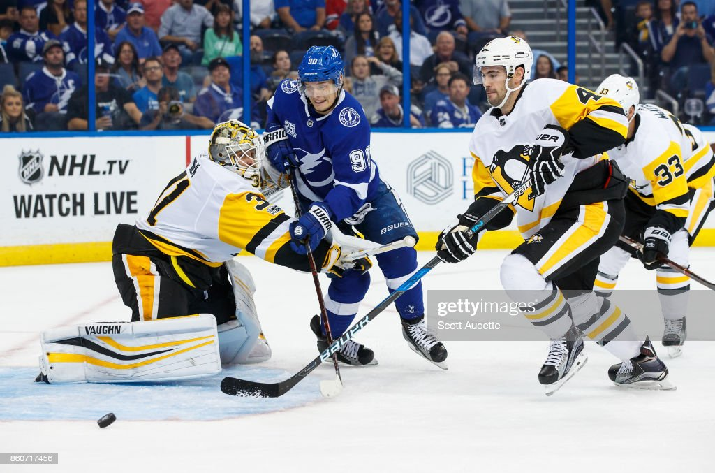 Vladislav Namestnikov #90 of the Tampa Bay Lightning skates against goalie Antti Niemi #31 and Justin Schultz #4 of the Pittsburgh Penguins during the third period at Amalie Arena on October 12, 2017 in Tampa, Florida.