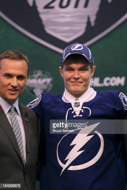 Vladislav Namestnikov poses with Steve Yzerman and other members of Tampa Bay Lightning during day one of the 2011 NHL Entry Draft at Xcel Energy...