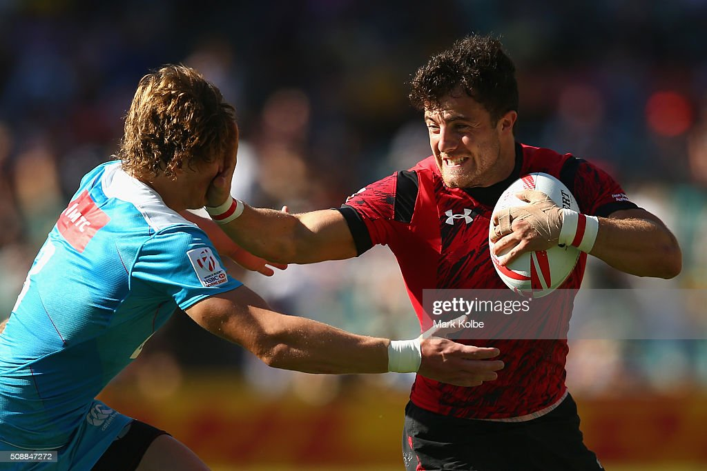 Vladislav Sozonov of Russia is fended away by Luke Morgan of Wales during the 2016 Sydney Sevens shield final match between Wales and Russia at Allianz Stadium on February 7, 2016 in Sydney, Australia.
