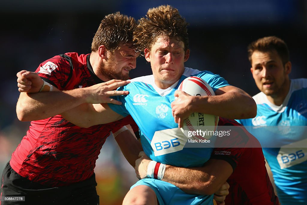 Vladislav Sozonov of Russia is tackled during the 2016 Sydney Sevens shield final match between Wales and Russia at Allianz Stadium on February 7, 2016 in Sydney, Australia.
