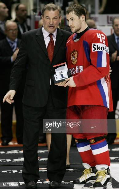 Vladislav Tretiak presents Sergei Zinovyev of Russia with a watch after his teams win over Canada during the Gold Medal Game of the International Ice...