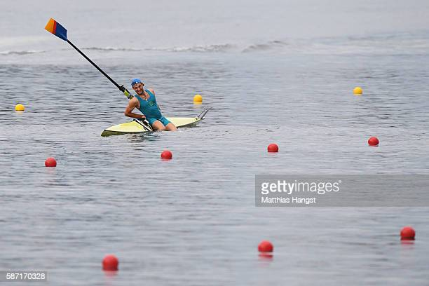 Vladislav Yakovlev of Kazakhstan capsizes competing in the Men's Single Sculls Repechage 1 on Day 3 of the Rio 2016 Olympic Games at the Lagoa...