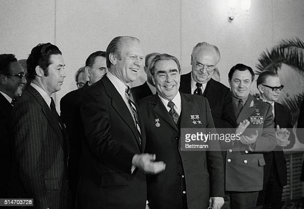 US Pres Gerald Ford chats with Soviet Communist Party Chief Leonid Brezhnev after signing agreement on guidelines for a treaty to limit offensive...