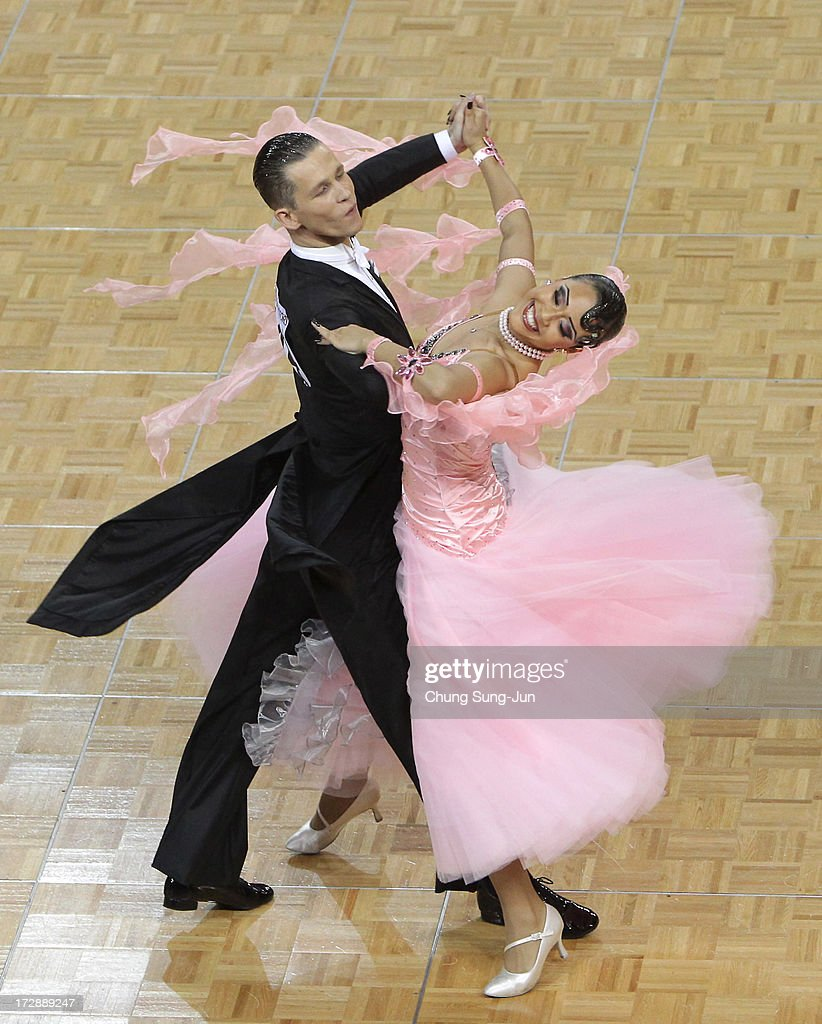 Vladlen Kravchenko and partner Aigerim Toktarova of Kazakhstan compete in the Dancesport- Standard Five Dances Waltz Final at Samsan World Gymnasium during day seven of the 4th Asian Indoor & Martial Arts Games on July 5, 2013 in Incheon, South Korea.