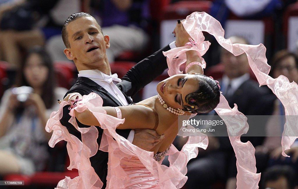 Vladlen Kravchenko and partner Aigerim Toktarova of Kazakhstan compete in the Dancesport- Standard Five Dances Viennese Waltz Final at Samsan World Gymnasium during day seven of the 4th Asian Indoor & Martial Arts Games on July 5, 2013 in Incheon, South Korea.