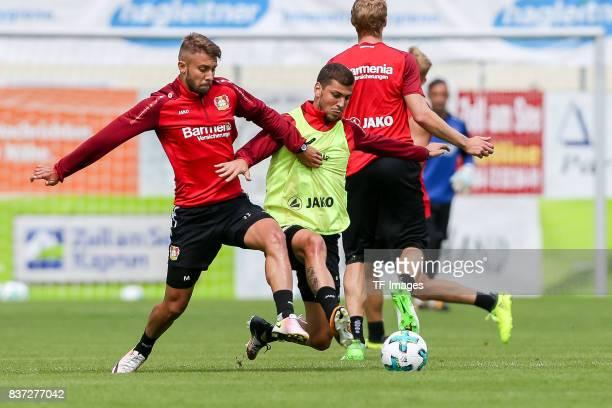 Vladlen Yurchenko of Bayer 04 Leverkusen Aleksandar Dragovic of Bayer 04 Leverkusen Stefan Kiessling of Bayer 04 Leverkusen battle for the ball...