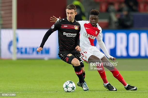 Vladlen Yurchenko of Leverkusen and Kevin N'Doram of Monaco battle for the ball during the UEFA Champions League match between Bayer Leverkusen and...