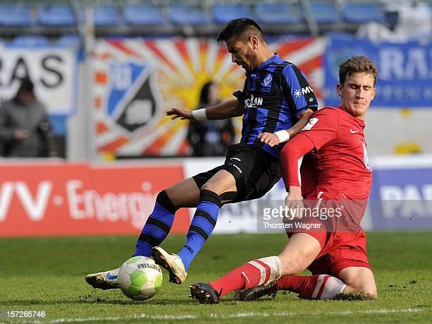 Vllaznim Dautaj of Mannheim battles for the ball with Matthias Rahn of Kassel during the fourth league match betwenn SV Waldhof Mannheim and Hessen...