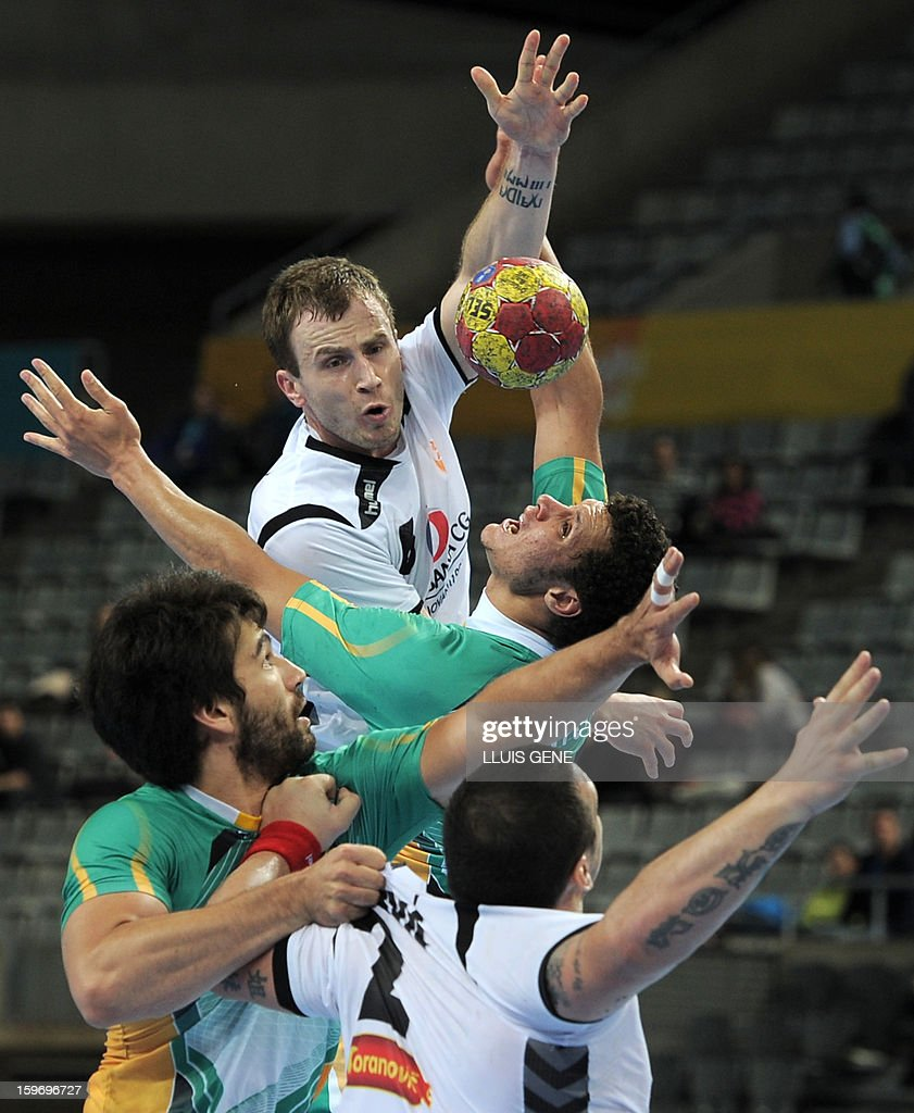 vMontenegro's right wing Fahrudin Melic (L) vies with Brazil's left back Thiagus Santos (R) during the 23rd Men's Handball World Championships preliminary round Group A match Montenegro vs Brazil at the Palau Sant Jordi in Barcelona on January 18, 2013.