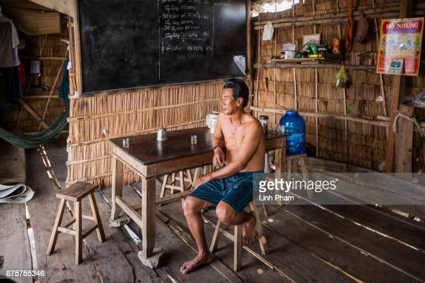 Vo Van Phuong sits at his clam guard hut next to the seafront on April 29 2017 in Bao Thuan Village Ba Tri District Ben Tre Province Vietnam He said...