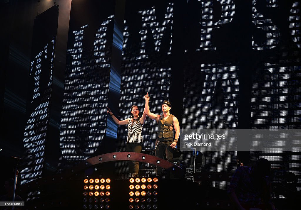 Vocal Duo of the Year - Singers/Songwriters Thompson Square who are <a gi-track='captionPersonalityLinkClicked' href=/galleries/search?phrase=Shawna+Thompson&family=editorial&specificpeople=7618655 ng-click='$event.stopPropagation()'>Shawna Thompson</a> and <a gi-track='captionPersonalityLinkClicked' href=/galleries/search?phrase=Keifer+Thompson&family=editorial&specificpeople=7618627 ng-click='$event.stopPropagation()'>Keifer Thompson</a> perform during the Dirt Road Diaries Tour 2013 on July 13, 2013 at Time Warner Cable Music Pavilion in Raleigh, North Carolina.
