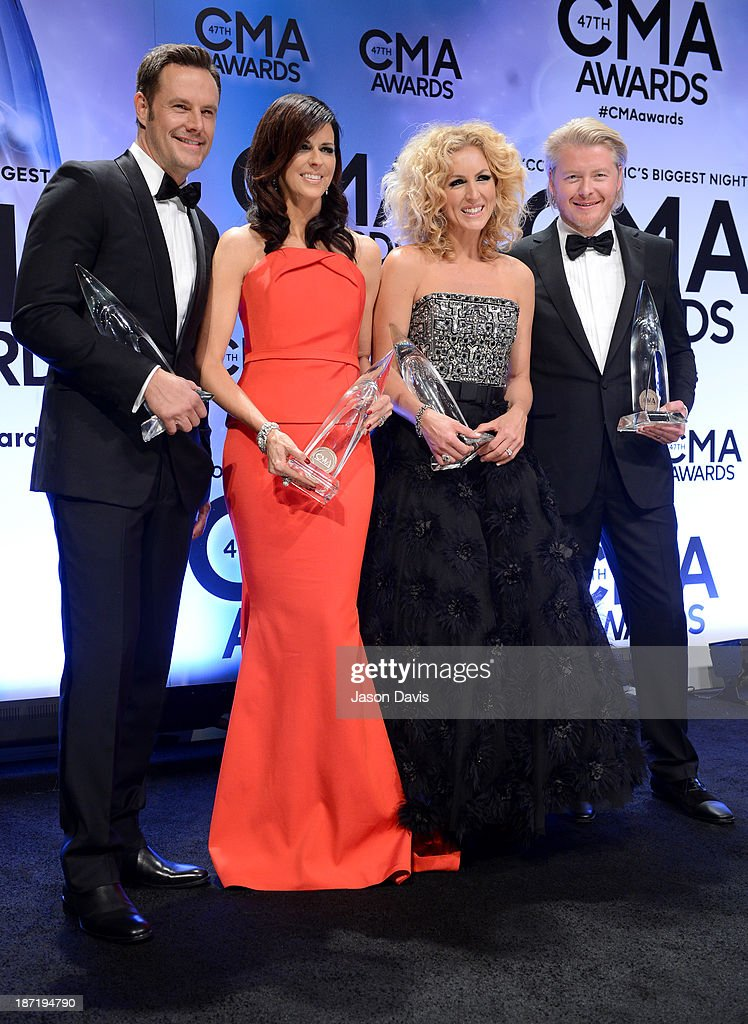 Vocal Group of the Year award winners Jimi Westbrook Karen Fairchild Kimberly Schlapman and Philip Sweet of Little Big Town pose in the press room...
