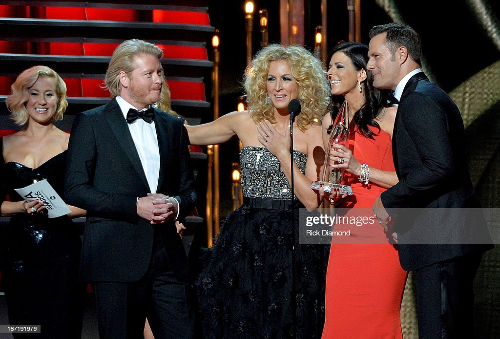 Vocal Group of the Year award winners Little Big Town, (L-R) Philip Sweet, Kimberly Schlapman, Karen Fairchild and Jimi Westbrook onstage during the 47th annual CMA awards at the Bridgestone Arena on November 6, 2013 in Nashville, United States.