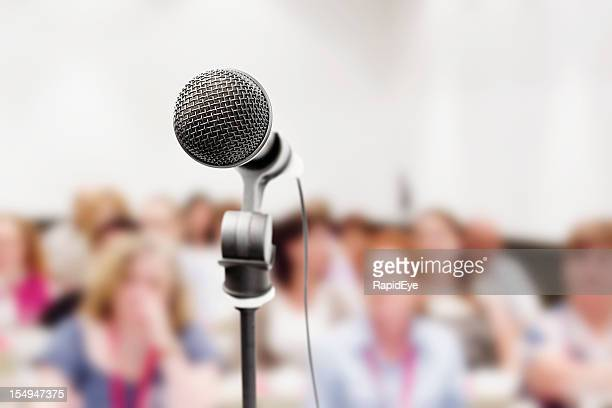 Vocal microphone in sharp focus against blurred audience