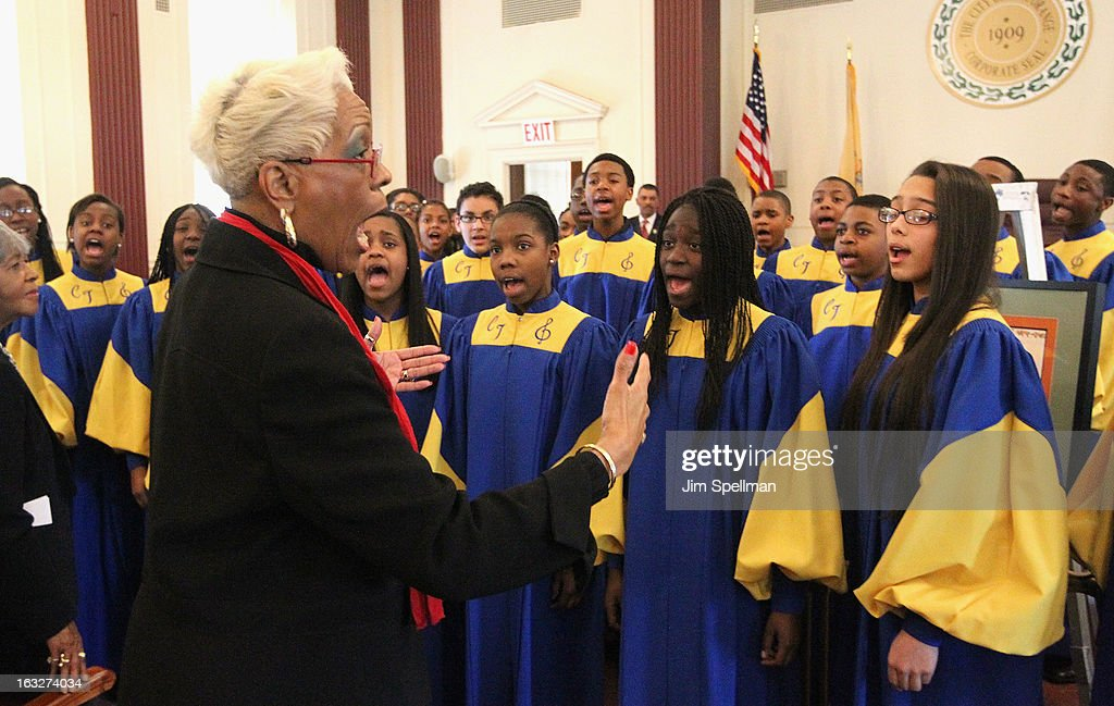 Vocal Music Teacher and Choir Director Jean James (L) and the Cicely L. Tyson Performing & Fine Arts Middle School choir attends the 150th Anniversary of East Orange, New Jersey at Council Chambers on March 6, 2013 in East Orange, New Jersey.