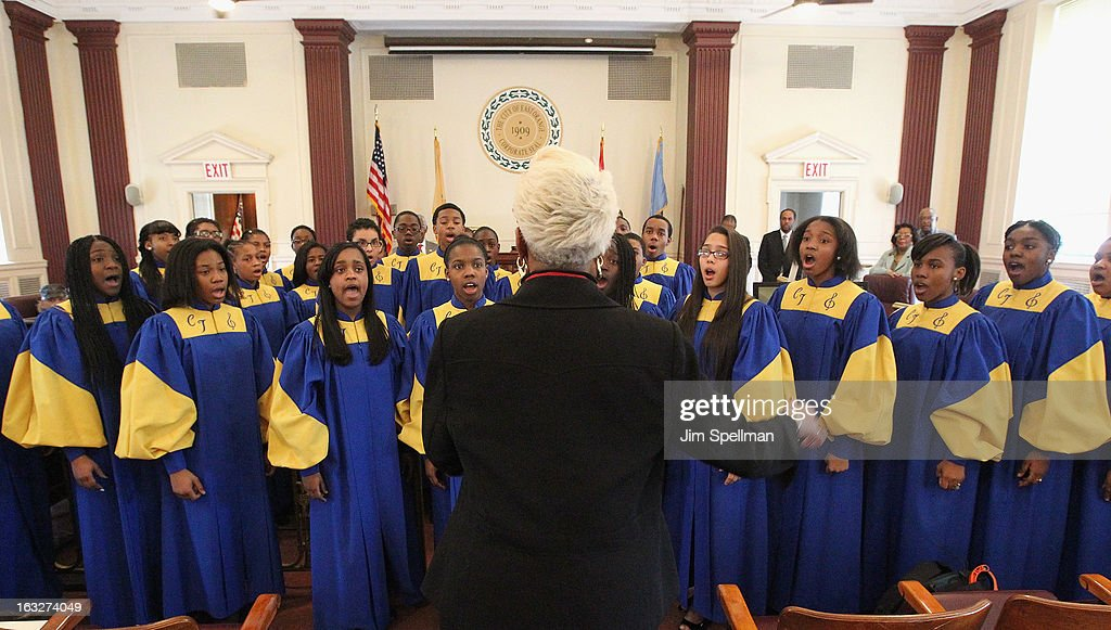 Vocal Music Teacher and Choir Director Jean James (M) and the Cicely L. Tyson Performing & Fine Arts Middle School choir attends the 150th Anniversary of East Orange, New Jersey at Council Chambers on March 6, 2013 in East Orange, New Jersey.