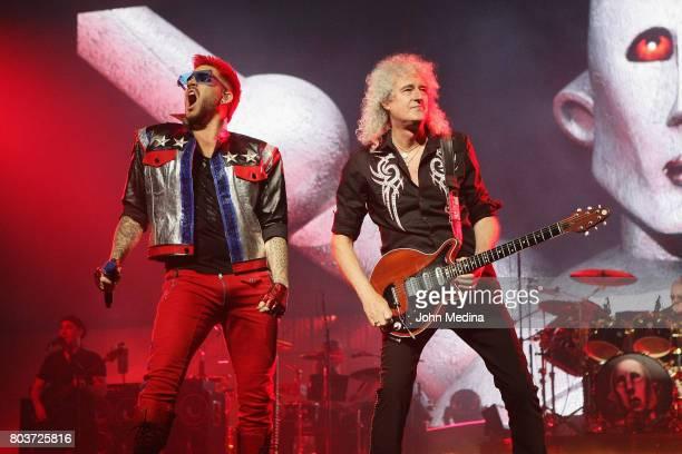 Vocalist Adam Lambert and guitarist Brian May of Queen Adam Lambert perform at SAP Center on June 29 2017 in San Jose California