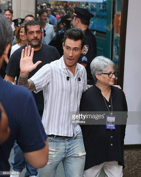 Vocalist Adam Levine walks through the crowd when Maroon 5 perform on NBC's 'Today' at Rockefeller Plaza on September 1 2014 in New York New York