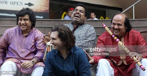 Vocalist and music director Shankar Mahadevan Flute genius Ronu Muzumdar Santoor maestro Rahul Sharma and Tabla exponent Aditya Kalyanpur pose...