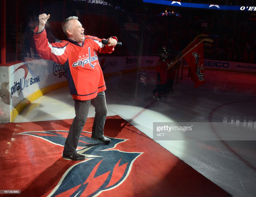 Vocalist Bob McDonald pumps his fist after singing the National Anthem before the game between the Washington Capitals and Winnipeg Jets at the Verizon Center in Washington, D.C., Tuesday, April 23, 2013. The Capitals defeated the Jets, 5-3, and claimed the NHL Southeast Division title.