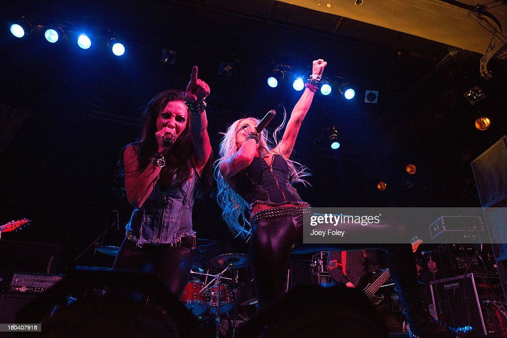 Vocalist Carla Harvey and Heidi Shepherd of Butcher Babies perform at Bogart's on January 19, 2013 in Cincinnati, Ohio.