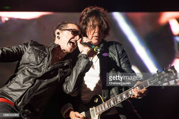 Vocalist Chester Bennington of Linkin Park and guitarist Dean DeLeo of Stone Temple Pilots perform at Verizon Wireless Amphitheater on May 18 2013 in...