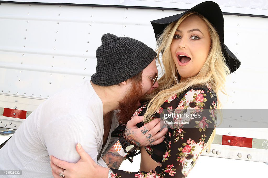 Vocalist Danny Worsnop of Asking Alexandria (L) and model Markie McManus pose backstage during the Vans Warped Tour on June 22, 2014 in Ventura, California.