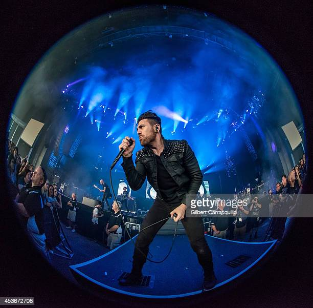 Vocalist Davey Havok of rock band AFI performs during The Carnivores Tour at the Susquehanna Bank Center on August 15 2014 in Camden New Jersey