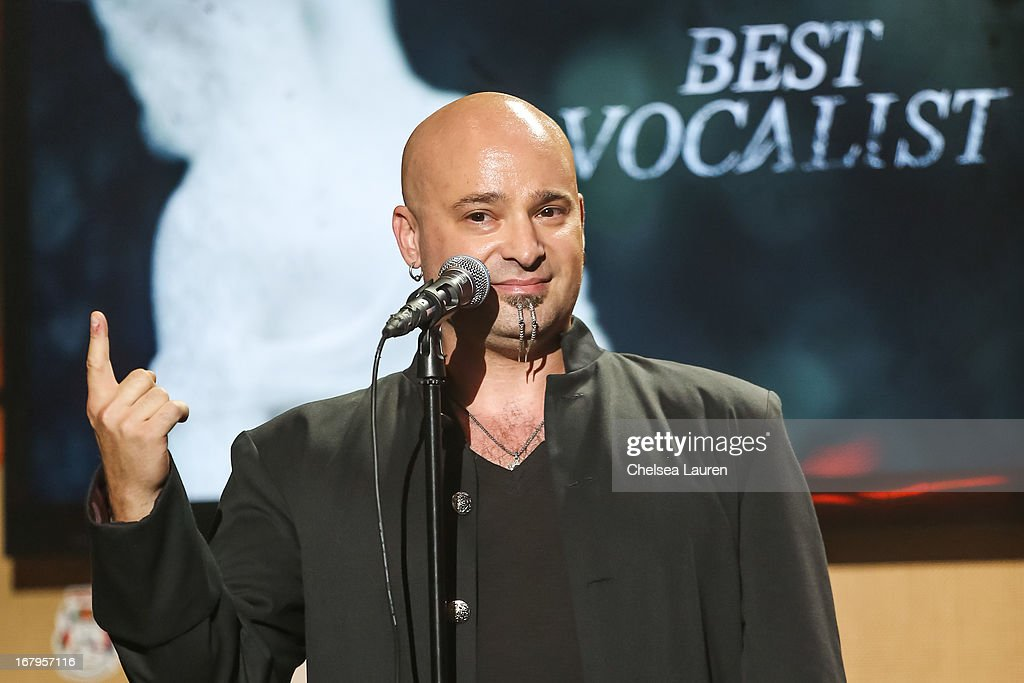 Vocalist <a gi-track='captionPersonalityLinkClicked' href=/galleries/search?phrase=David+Draiman&family=editorial&specificpeople=549613 ng-click='$event.stopPropagation()'>David Draiman</a> of Distrubed / Device presents the 'Best Vocalist' award at the 5th annual Revolver Golden Gods award show at Club Nokia on May 2, 2013 in Los Angeles, California.
