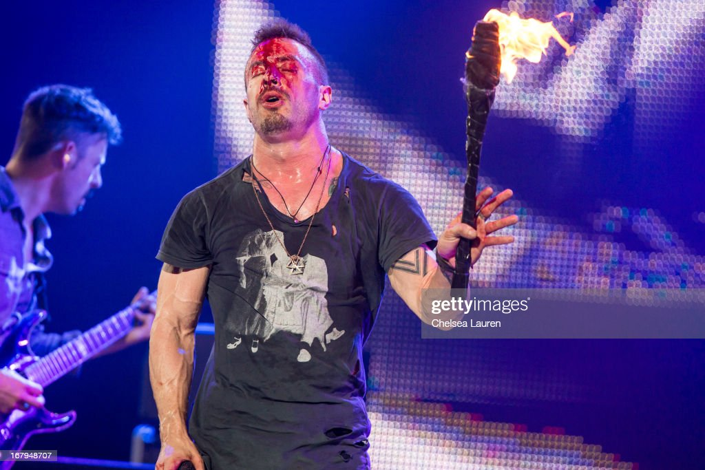 Vocalist <a gi-track='captionPersonalityLinkClicked' href=/galleries/search?phrase=Greg+Puciato&family=editorial&specificpeople=5721343 ng-click='$event.stopPropagation()'>Greg Puciato</a> of The Dillinger Escape Plan performs at the 5th annual Revolver Golden Gods award show at Club Nokia on May 2, 2013 in Los Angeles, California.