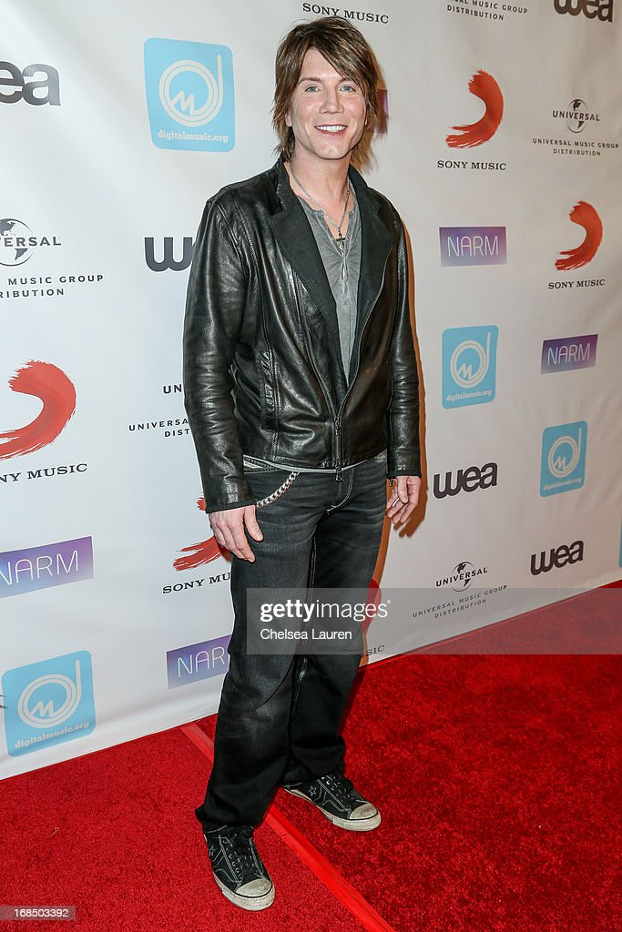 Vocalist / guitarist John Rzeznik of the Goo Goo Dolls arrives at the NARM Music Biz Awards dinner party at the Hyatt Regency Century Plaza on May 9, 2013 in Century City, California.