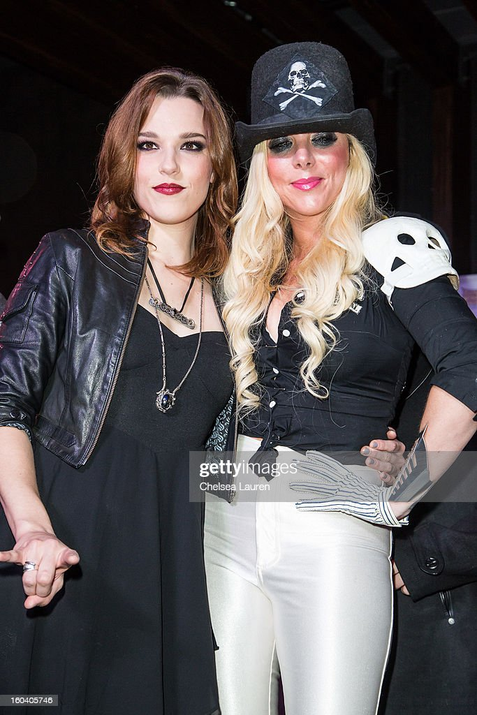 Vocalist / guitarist Lzzy Hale of Halestorm (L) and vocalist Maria Brink of In This Moment attend the Revolver Golden Gods Awards press conference at Hard Rock Cafe - Hollywood on January 30, 2013 in Hollywood, California.