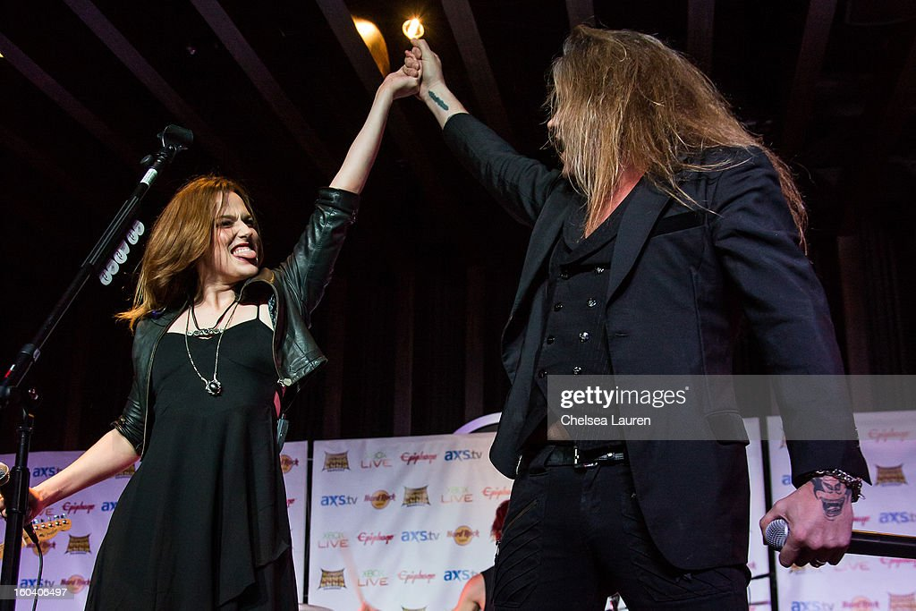 Vocalist / guitarist Lzzy Hale of Halestorm (L) and vocalist Sebastian Bach of Skid Row perform at the Revolver Golden Gods Awards press conference at Hard Rock Cafe - Hollywood on January 30, 2013 in Hollywood, California.